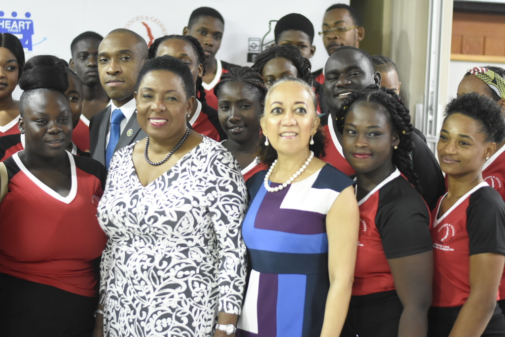Entertainment and Culture Minister Olivia Grange (front row/ centre), Dianne Ashton-Smith, head of corporate affairs at Red Stripe and Andrew Spencer, executive director of TPDco (second row) pose for a photo with the first batch of youngsters to be trained under the programme.