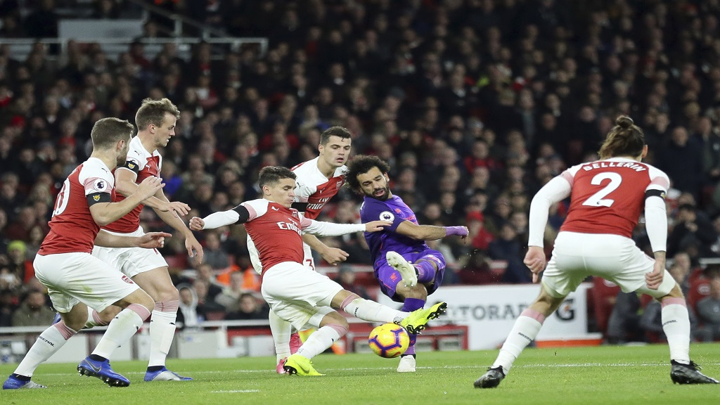 Liverpool's Mohamed Salah, center right, attempts a shot at goal during the English Premier League football match against Arsenal at the Emirates stadium in London, England, Saturday, Nov. 3, 2018.