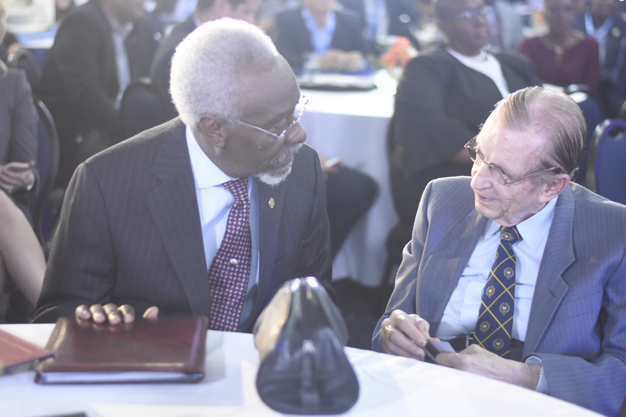 Former prime ministers PJ Patterson (left) and Edward Seaga in discussion earlier this year at the Jamaica Stock Exchange annual conference. (PHOTO: Marlon Reid)
