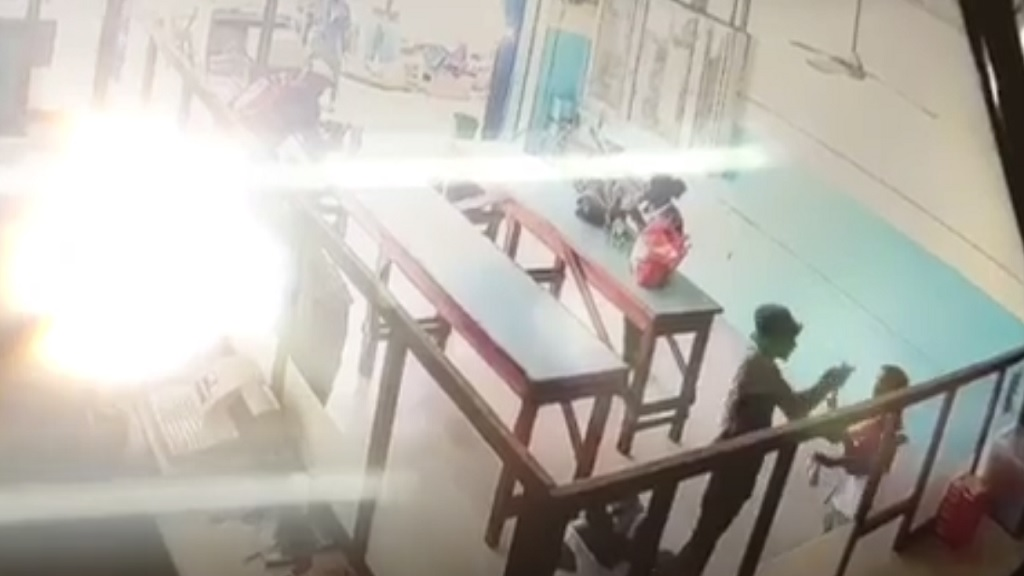 A technically adjusted screen grab from CCTV footage of a murder at a restaurant in downtown Kingston on Friday.