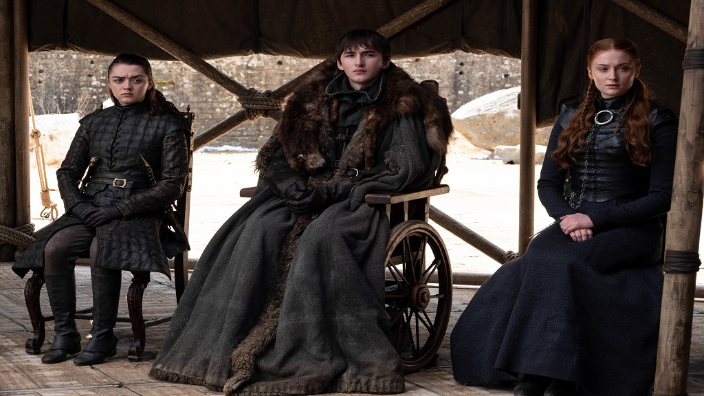 "This image released by HBO shows from left to right Maisie Williams, Isaac Hempstead Wright and Sophie Turner in a scene from the final episode of ""Game of Thrones,"" that aired Sunday, May 19, 2019. (HBO via AP)"
