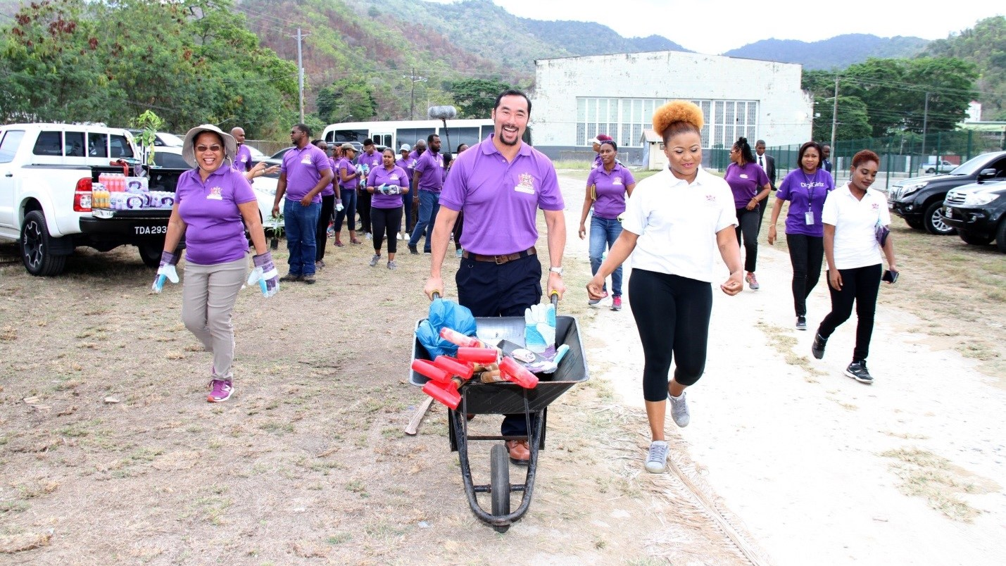 Minister of Communications, Stuart Young (centre) shares a light moment with Minister of Community Development, Culture and the Arts, Dr Nyan Gadsby-Dolly before the start of the Trash Tag event at Chagville Beach in Chaguaramas