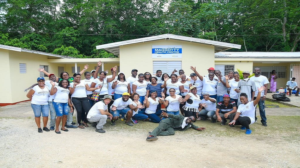 Joint volunteers teams from the J Wray and Nephew Limited family pause for a group shot while on Labour Day duties in Maggotty, St Elizabeth last week