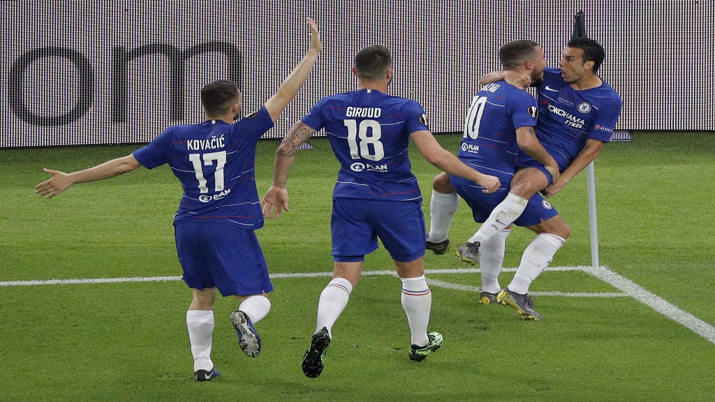 Chelsea's Pedro Rodriguez, right,  celebrates with teammates, from left, Mateo Kovacic, Olivier Giroud and Eden Hazard after scoring his team's second goal during the Europa League Final against Arsenal at the Olympic stadium in Baku, Azerbaijan, Wednesday, May 29, 2019.