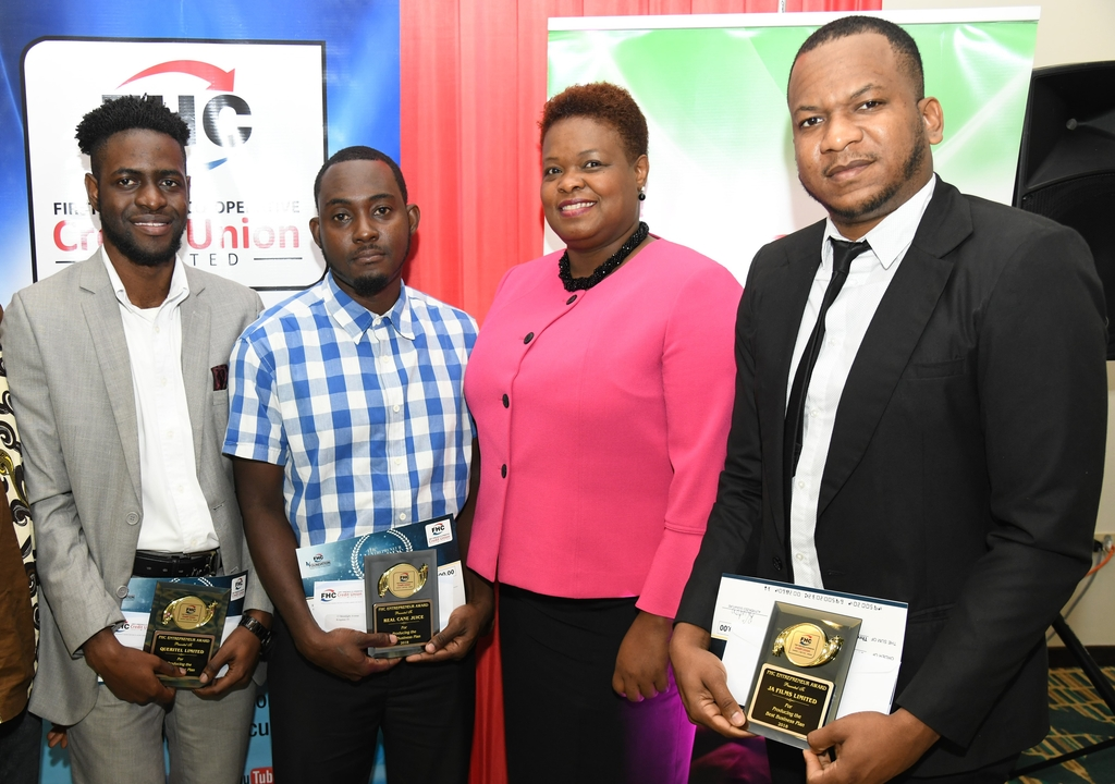 "Roxann Linton (second from right), CEO of First Heritage Co-operative Credit Union (FHCCU) and (from left) Kevonne Martin of online research service Queritel. Devorue Junior of juice company Real Cane; and Shani Bennett and Andre Wynter of JA Films (producers of the hit Jamaican TV series ""Real Friends"")."