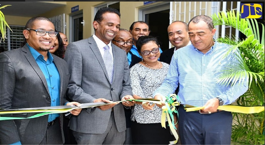 Health Minister, Dr.  Christopher Tufton (right), cuts the ribbon to reopen the renovated Black River Health Centre, in St. Elizabeth. Also sharing the moment are Minister of State in the Ministry of Industry, Commerce, Agriculture and Fisheries and Member of Parliament for the area, Floyd Green (left); Executive Director of the Tourism Enhancement Fund (TEF), Dr. Carey Wallace (second left), and Chief Medical Officer in the Ministry of Health, Dr. Jacqueline A. Bisasor-McKenzie.