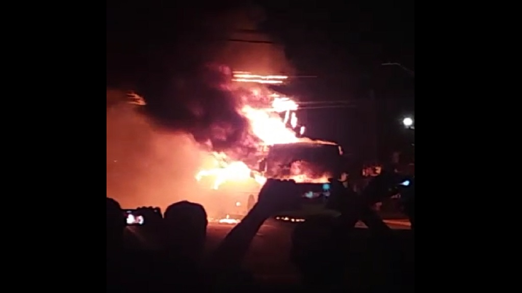 Screen grab of video showing a JUTC bus on fire in Half-Way Tree on Tuesday evening.