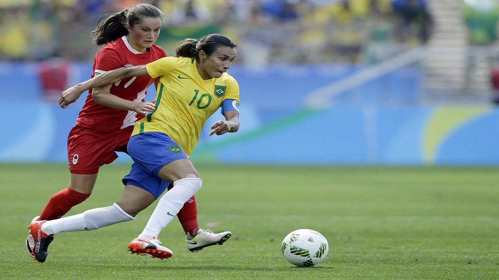 In this August 19, 2016, file photo, Brazil's Marta, left, dribbles past Canada's Jessie Fleming during the bronze medal women' football match at the summer Olympic's at the Arena Corinthians stadium in Sao Paulo.