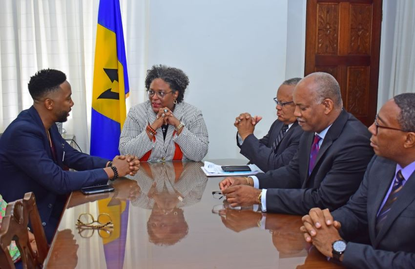 Prime Minister Mia Amor Mottley​ in discussion with Ndaba Mandela as Ministers look on.