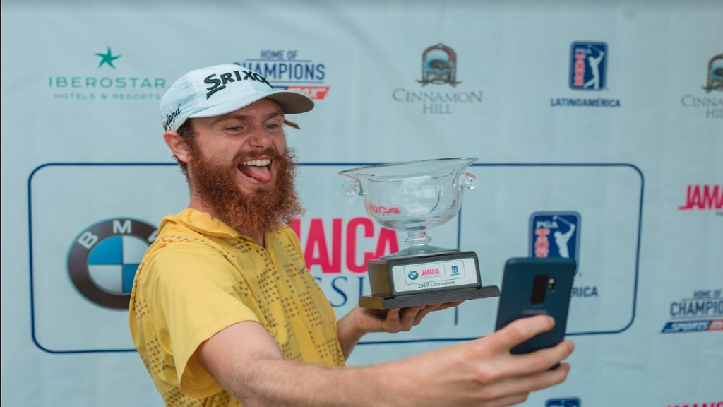 American Evan Harmeling takes a selfie with the  PGA Latinoamerica BMW Jamaica Golf Classic main prize following his victory at the Cinnamon Hill Golf Course in Montego Bay on Sunday, May 19, 2019.
