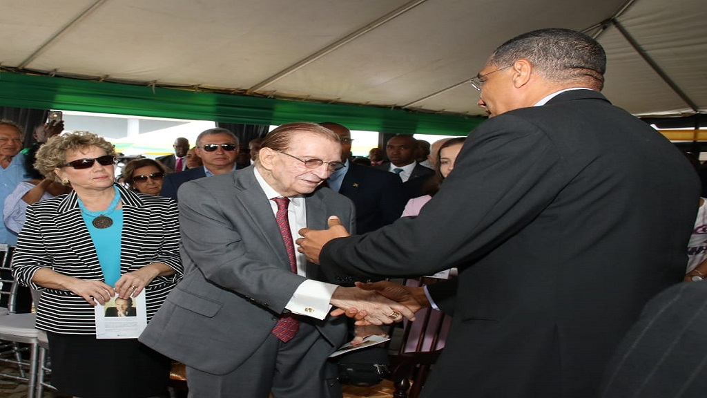 Former Prime Minister Edward Seaga (centre) being greeted by Prime Minister Andrew Holness at the renaming ceremony of the North South Highway in June 2018. Seaga's wife, Carla (right) looks on.