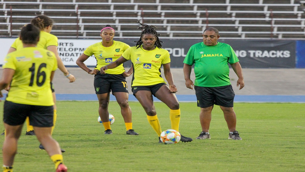 Jamaica's senior women's head coach, Hue Menzies watches his players at a training session at the National Stadium on Monday, May 13, 2019. (PHOTOS: Lennox Aldred).