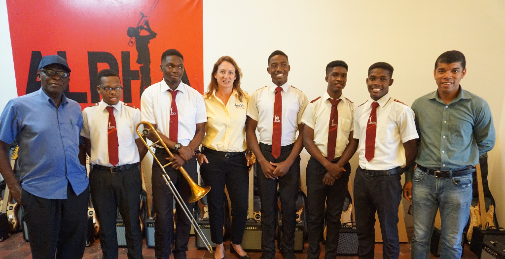 Sandals Foundation Executive Director, Heidi Clarke (centre) with Alpha Institute students and teachers.