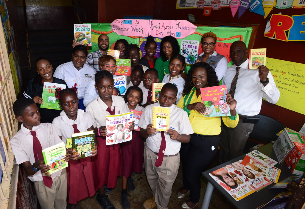 Supreme Ventures staff volunteers donated books to Greenwich Primary School on Read Across Jamaica Day on May 7 as part of their outreach for the day.