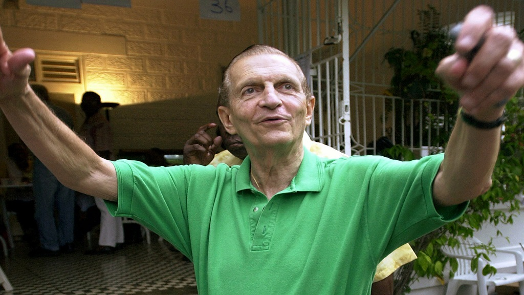 In this October 16, 2002 file photo, former Jamaican Prime Minister Edward Seaga leaves a polling station after voting in the general election, in Kingston, Jamaica. Seaga, who shaped the island s post-independence politics and cultural life, died Tuesday, May 28, 2019. Seaga was 89. (AP Photo/Andres Leighton, File)