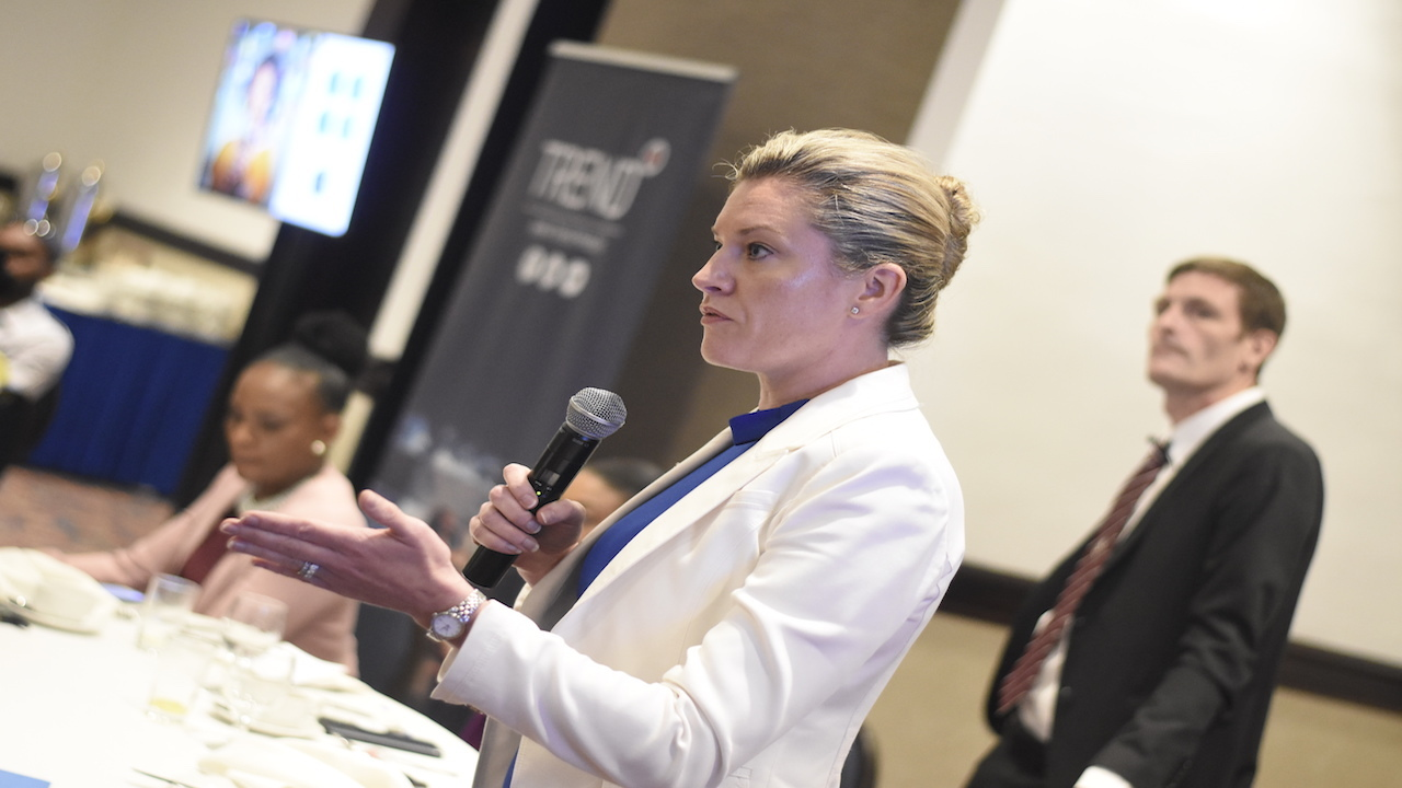 In this file photo, Trend Media CEO Aileen Corrigan addresses audience members during a presentation. Also pictured are Declan Tully, head of revenue; and Kishner Cowell, head of sales at Trend Media.