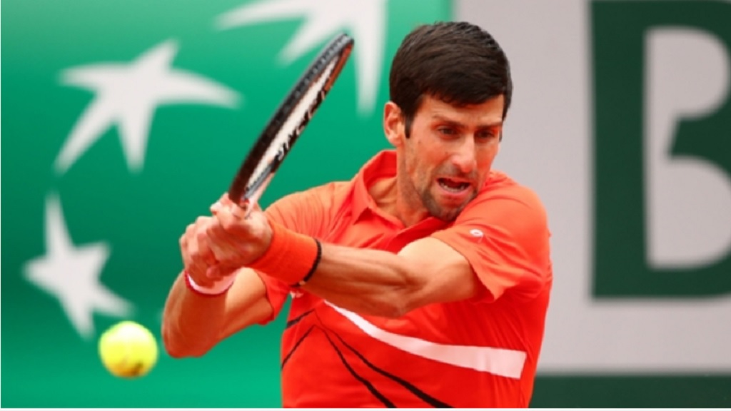 Novak Djokovic in action against Henri Laaksonen.