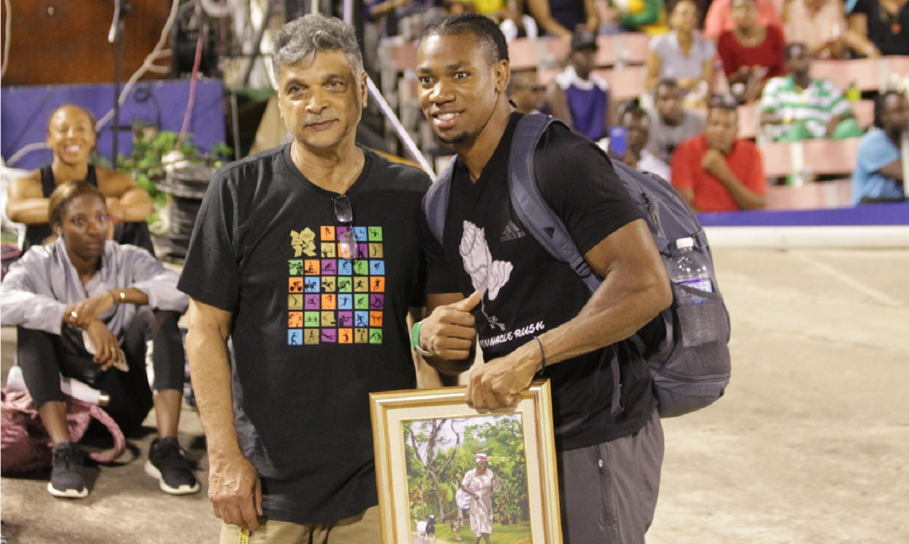 2011 World Championship 100m gold medallist, Yohan Blake (right) and manager Cubie Seegobin.