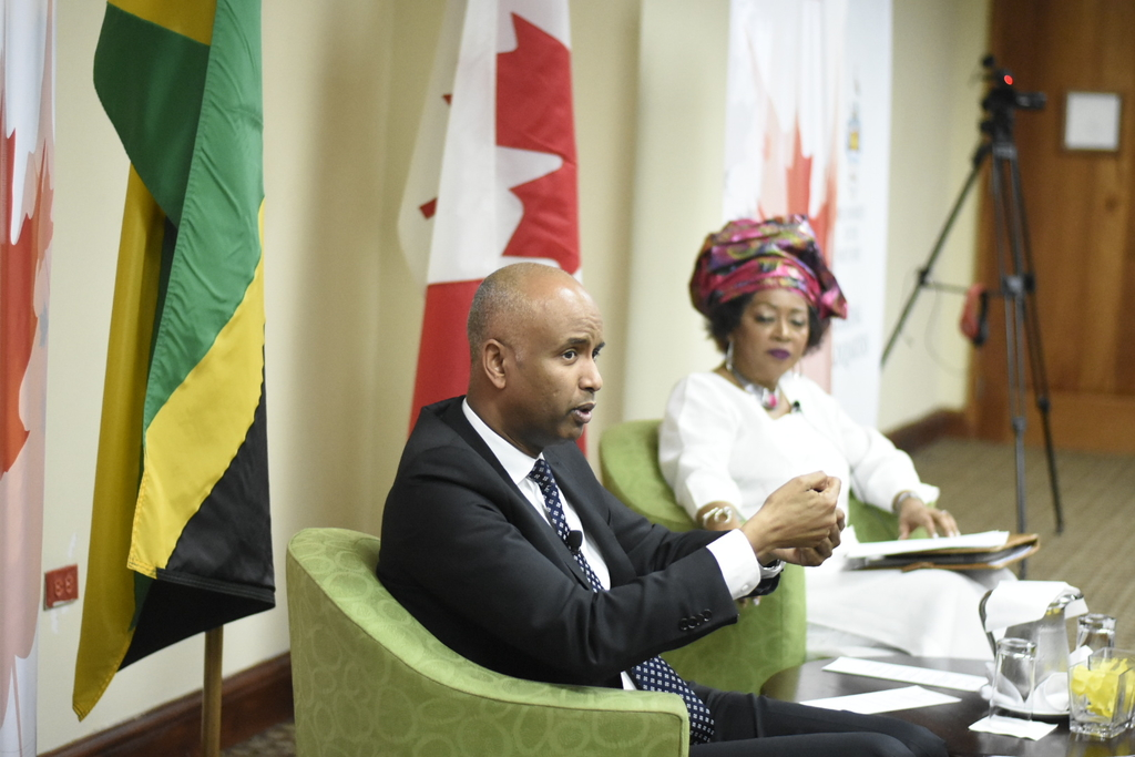 Canada's Minister of Immigration, Refugee and Citizenship, Ahmed Hussen speaking at a forum organised by the Canadian High Commission to Jamaica and The University of the West Indies. Also pictured is Professor Professor Verene Shepherd. (Photo: Marlon Reid)