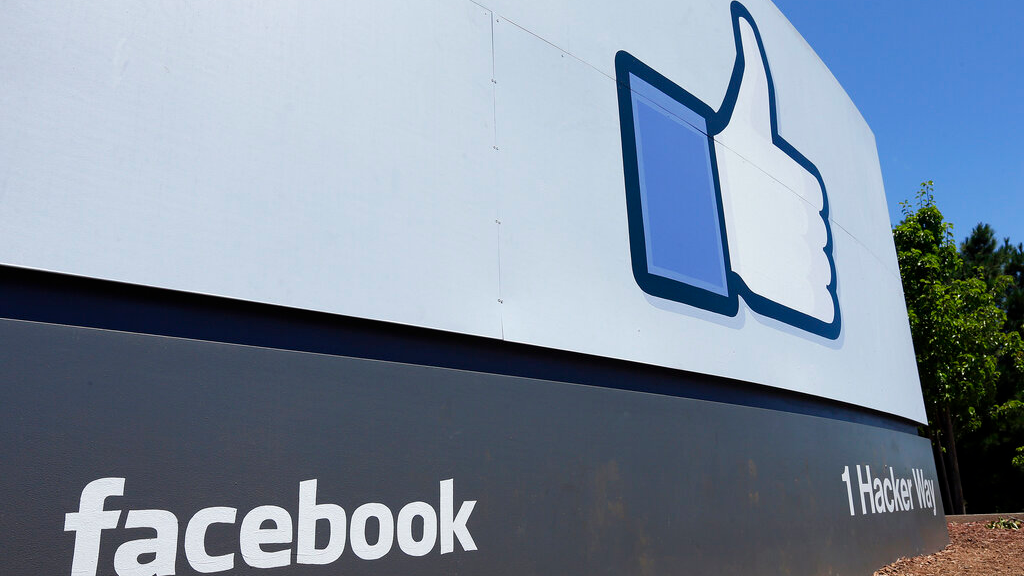 FILE - This July 16, 2013 file photo shows a sign at Facebook headquarters in Menlo Park, Calif. (AP Photo/Ben Margot, File)