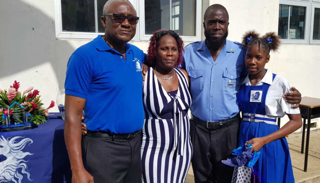 Transport Board Bus Driver, Dale Hall (second right), is seen here with from left, Member of The Lodge School's PTA, Desmond Burgess, mother of Allisha Downes, Allison Ross, and Allisha. (BGIS)