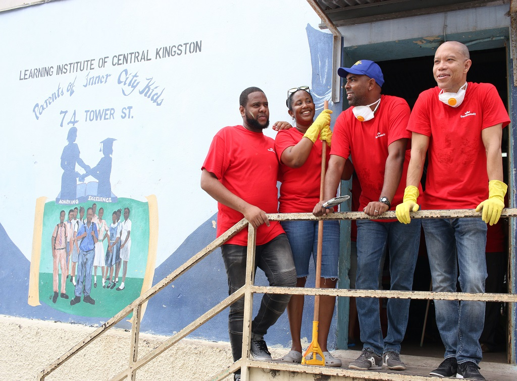 Nationwide News Reporter William Mitchell (left) takes a breather from painting inside The Learning Institute of Central Kingston, one of the Grace & Staff Community Development Foundation's many homework centres, along with Tanketa Chance-Wilson, the foundation's General Manager; Steven Whittingham (second right), Managing Director of GK Insurance; and Andrew Leo-Rhynie, Managing Director of GK Capital Management.