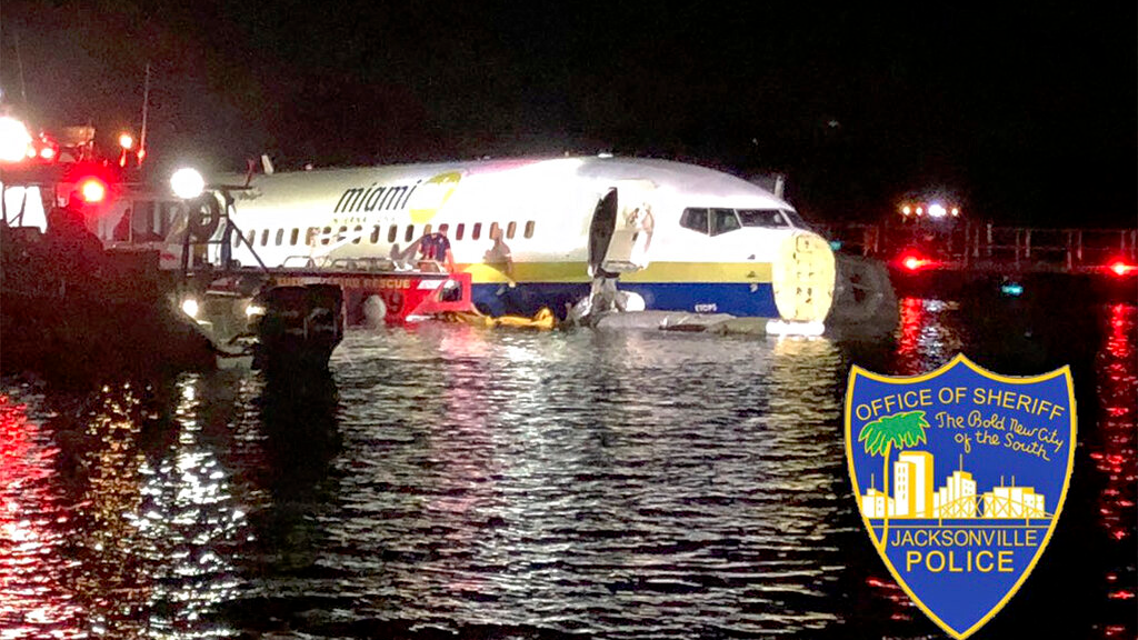 In this photo released by the Jacksonville Sheriff's Office, authorities work at the scene of a plane in the water in Jacksonville, Fla., Friday, May 3, 2019. (Jacksonville Sheriff's Office via AP)