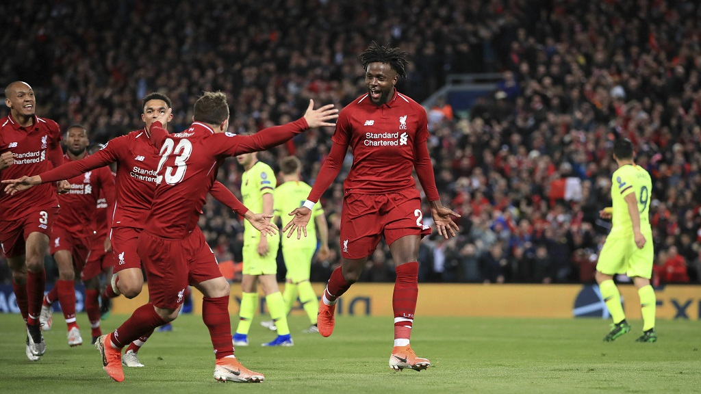 Liverpool's Divock Origi, center, celebrates scoring his side's fourth goal of the game during the Champions League Semi Final, second leg football match against Barcelona at Anfield, Liverpool, England, Tuesday, May 7, 2019.