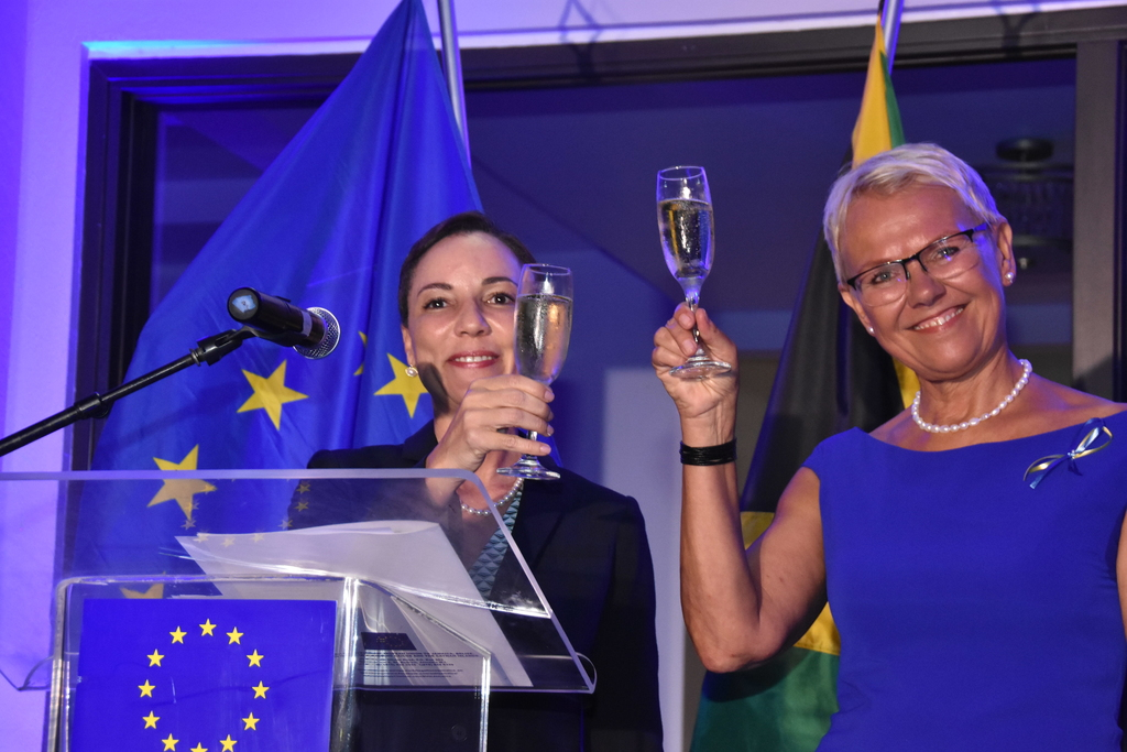 Head of the European Union (EU) Delegation to Jamaica, Ambassador Malgorzata Wasilewska (right) and Minister of Foreign Affairs and Foreign Trade, Kamina Johnson Smith raise a toast to celebrate EU's longstanding relationship with Jamaica.