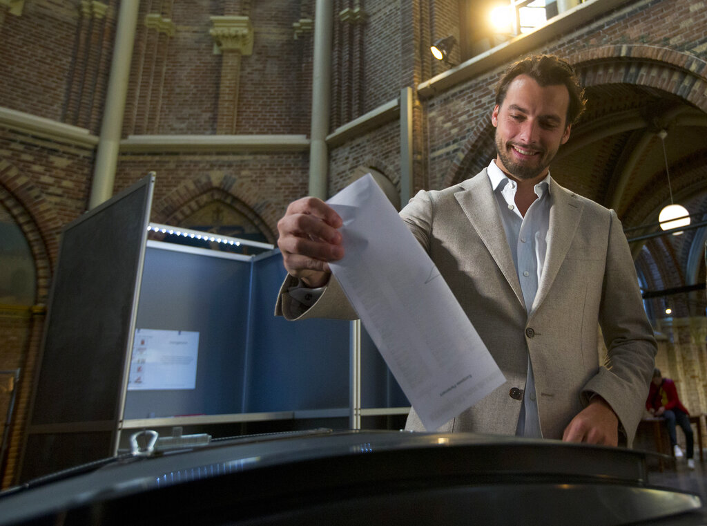 Thierry Baudet, leader of the populist party Forum for Democracy, casts his ballot for the European elections in Amsterdam, Netherlands, Thursday, May 23, 2019. (AP Photo/Peter Dejong)