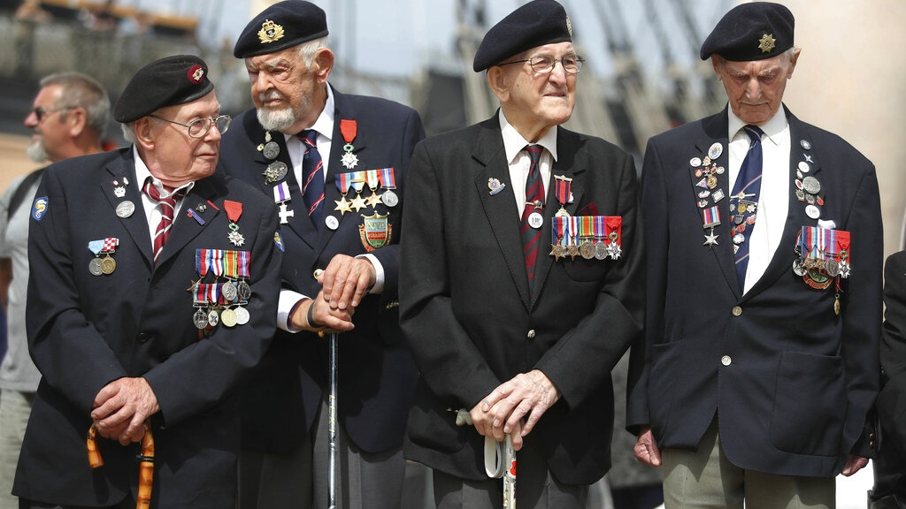 D-Day veterans gather during a D-Day commemoration event at the Historical Dockyard in Portsmouth, southern England, Sunday June 2, 2019. There are many events over the coming days to mark the 75th anniversary of the landings by the Allied forces on Tuesday June 6, 1944, in Normandy, France, that became known as D-Day. (Andrew Matthews/PA via AP)
