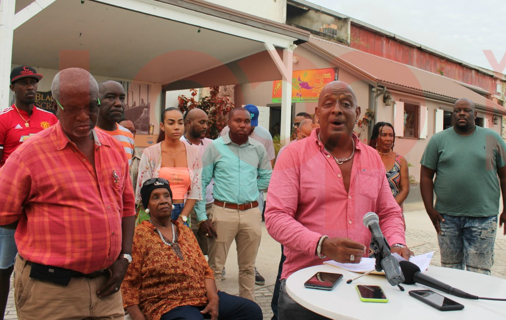 President Chetwin Stewart (pink shirt) with members of BAM in the background.