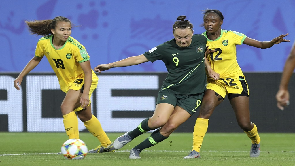 Australia's Caitlin Foord, centre, fights for the ball with the Jamaican pair of Sashana Campbell, right, Toriana Patterson during the Women's World Cup Group C football match  at Stade des Alpes stadium in Grenoble, France, Tuesday, June 18, 2019.