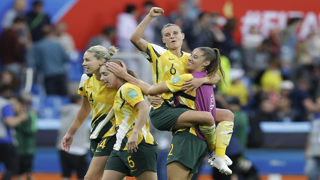 Australia's Chloe Logarzo, top, celebrates with a teammate at the end of the Women's World Cup Group C football match against Brazil at Stade de la Mosson in Montpellier, France, Thursday, June 13, 2019. Australia defeated Brazil 3-2.