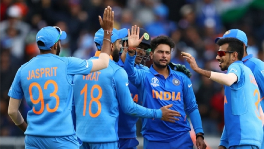 India celebrate a wicket against Pakistan.
