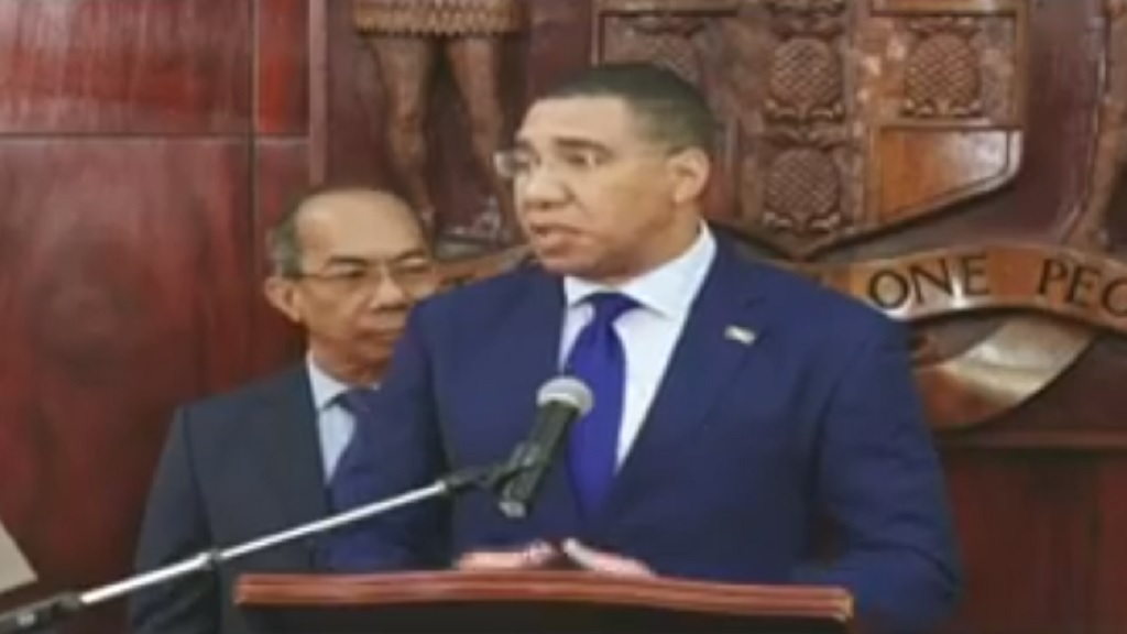 Prime Minister Andrew Holness addresses journalists at a emergency press conference on Tuesday morning.