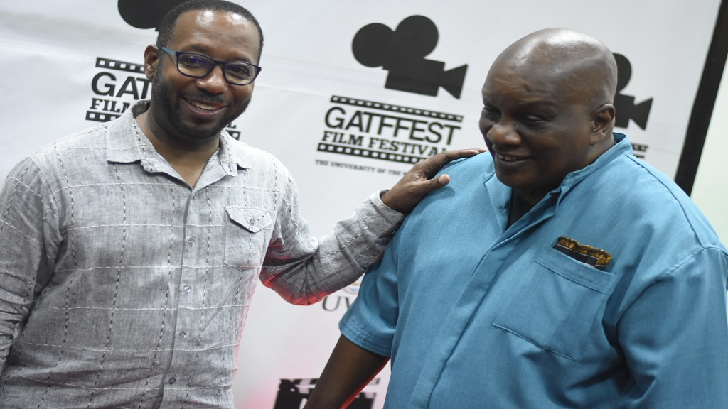 Gatffest director Ian Boxhill (left) with local filmmaker Lennie Little-White at the launch of the festival on Thursday. (PHOTOS: Marlon Reid)