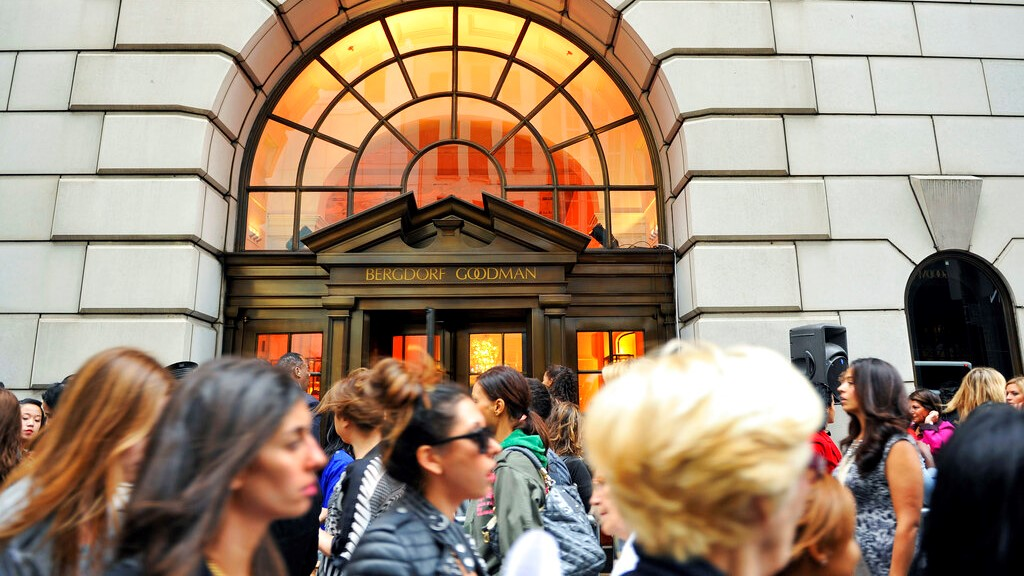This Sept 10, 2010, file photo shows people lining up to enter the Bergdorf Goodman store, in New York. (AP Photo/Stephen Chernin, File)