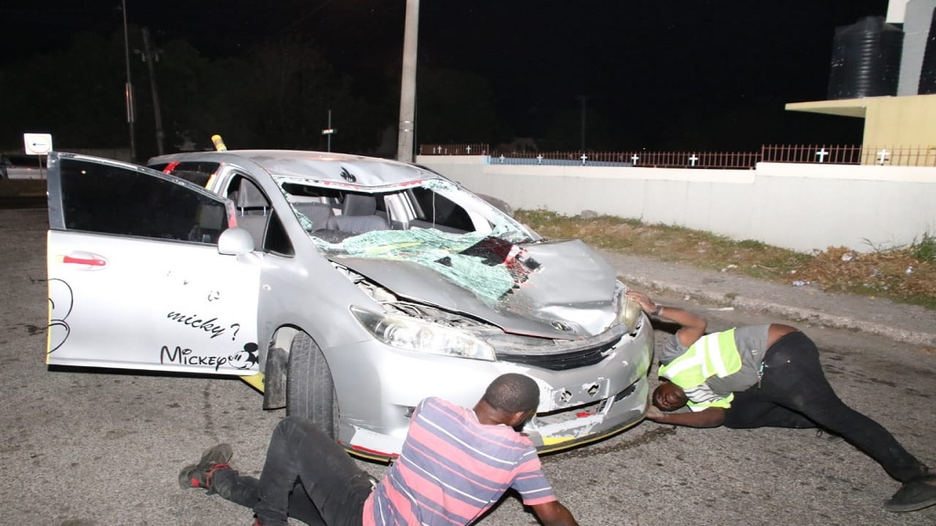 This crashed vehicle minus its licence plates, was at the scene of a fatal collision on Washington Boulevard in St Andrew on Tuesday night.