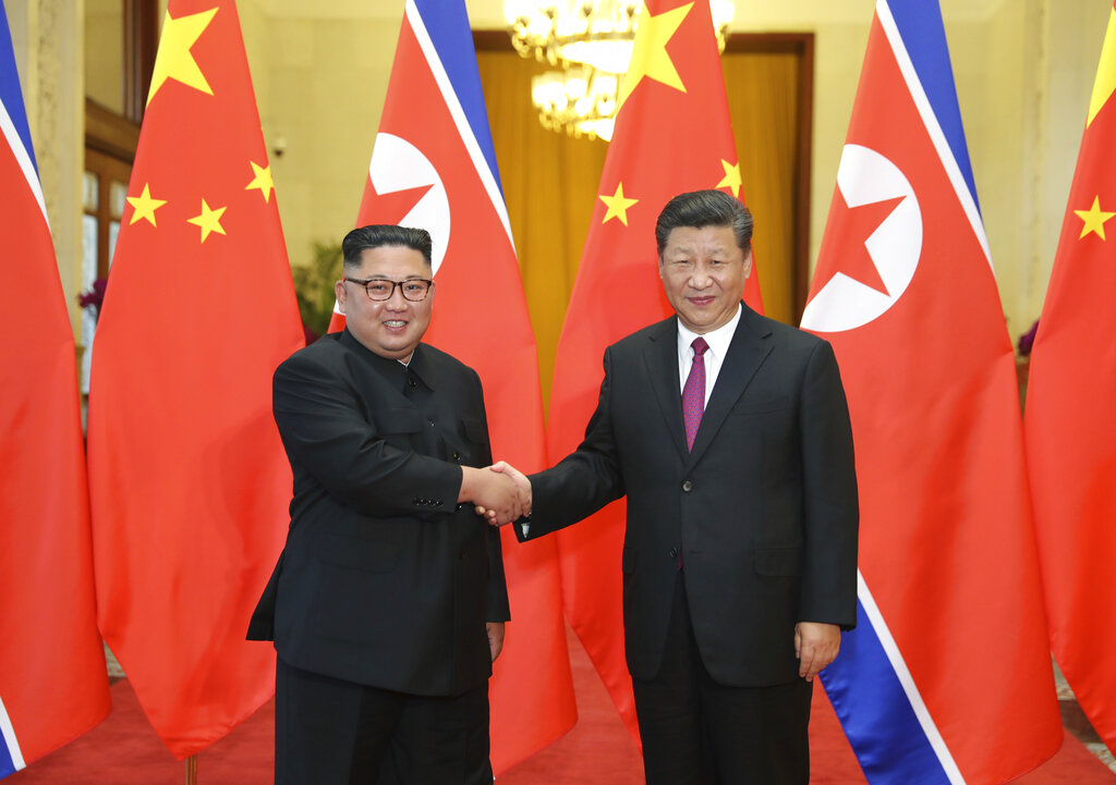 In this June 19, 2018, file photo released by China's Xinhua News Agency, Chinese President Xi Jinping, right, poses with North Korean leader Kim Jong Un for a photo during a welcome ceremony at the Great Hall of the People in Beijing. (Ju Peng/Xinhua via AP, File)