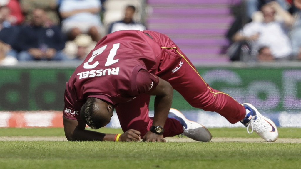 West Indies' Andre Russell gets up before walking off the field of play with an injury after bowling during the Cricket World Cup match against England at the Hampshire Bowl in Southampton, England, Friday, June 14, 2019.