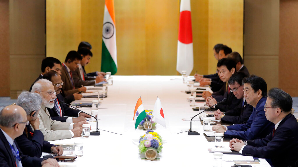 Indian Prime Minister Narendra Modi, third from left, speaks to his Japanese counterpart Shinzo Abe, second from right, during a bilateral meeting ahead of the G-20 Summit in Osaka, western Japan, Thursday, June 27, 2019. (Kiyoshi Ota/Pool Photo via AP)