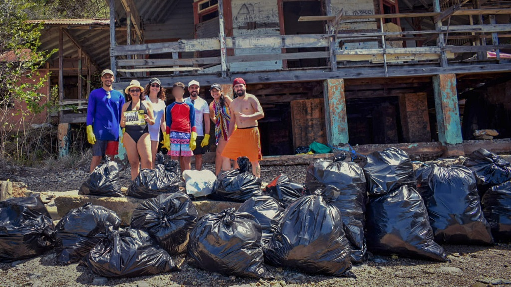 Photo: Members of the Venezuelan community in Trinidad took part in the #trashtag challenge to clean up part of Chacachacare Island. The post has gone viral online. Photos courtesy Instagram user @orlanphotos/Orlando Martinez.