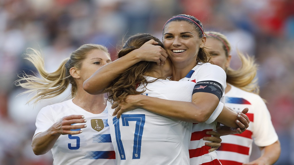 In this July 26, 2018, file photo, U.S. forward Alex Morgan, second from right, celebrates her hat trick with defender Tobin Heath (17) and other teammates during the second half of a Tournament of Nations football match against Japan in Kansas City, Kan.