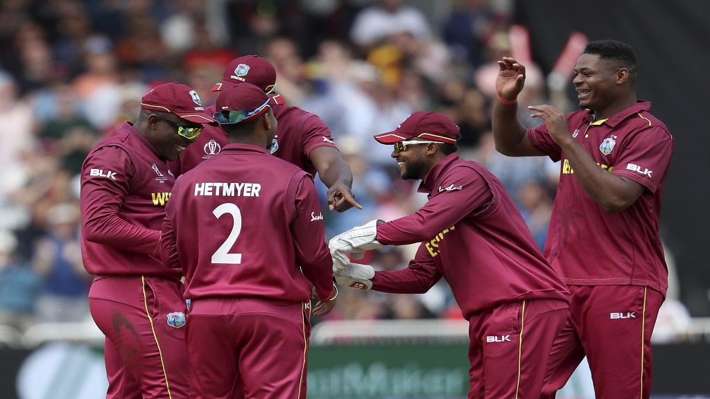 West Indies' Oshane Thomas, right, celebrates with teammates the dismissal of Australia's Steve Smith during the Cricket World Cup match  at Trent Bridge in Nottingham, Thursday, June 6, 2019.