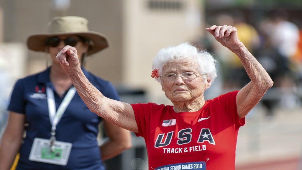 In this photo provided by the National Senior Games Association, 103-year-old Julia Hawkins, of Baton Rouge, La., celebrates after completing the 50-metre dash at the 2019 National Senior Games in Albuquerque, N.M., Monday, June 17, 2019.