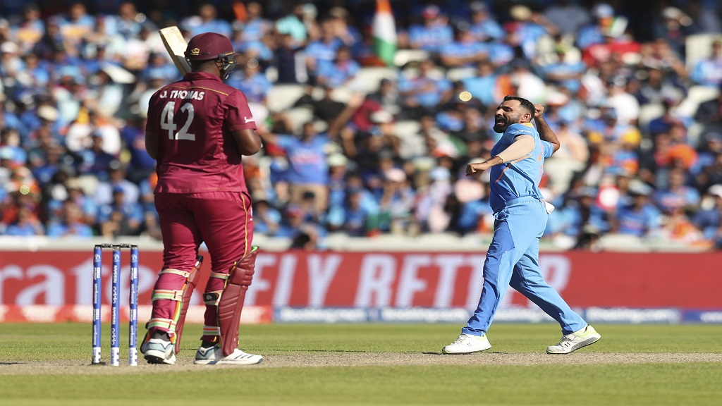 India's Mohammed Shami celebrates after taking the last wicket of the game West Indies' Oshane Thomas during the Cricket World Cup match  at Old Trafford in Manchester, England, Thursday, June 27, 2019.