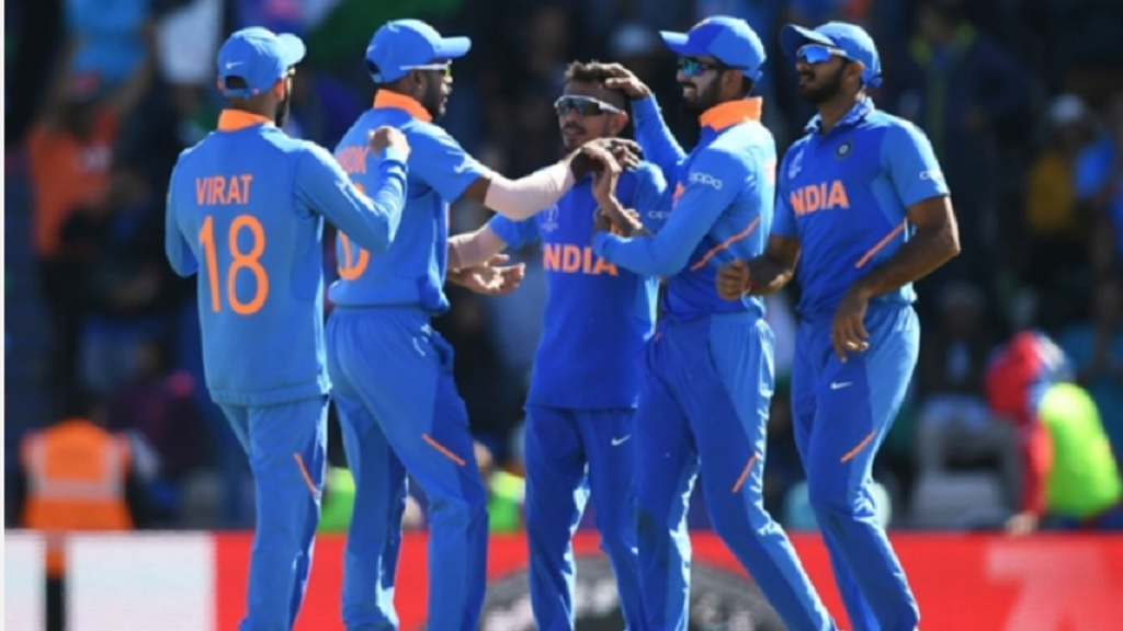 India celebrate the wicket of Rahmat Shah.