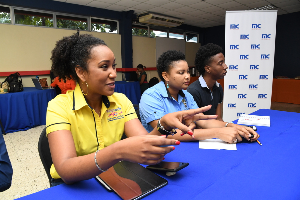 Kalilah Reynolds (left), business editor at Nationwide advising on how to protect one's work. In the background are: Marilyn Allen, lecturer in communications at the University of Technology (UTech) and Namiko Harris, acting technical officer at UTech.