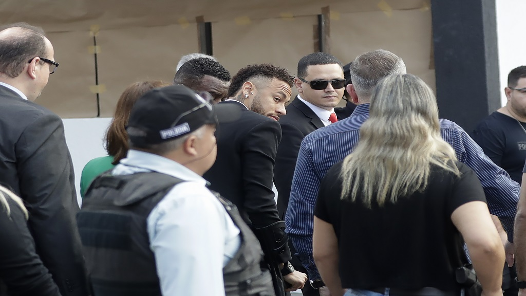 Brazilian football star Neymar, center, arrives at a police station to testify, after a woman accused him of rape, in Sao Paulo, Brazil, Thursday, June 13, 2019. Neymar denies any wrongdoing.